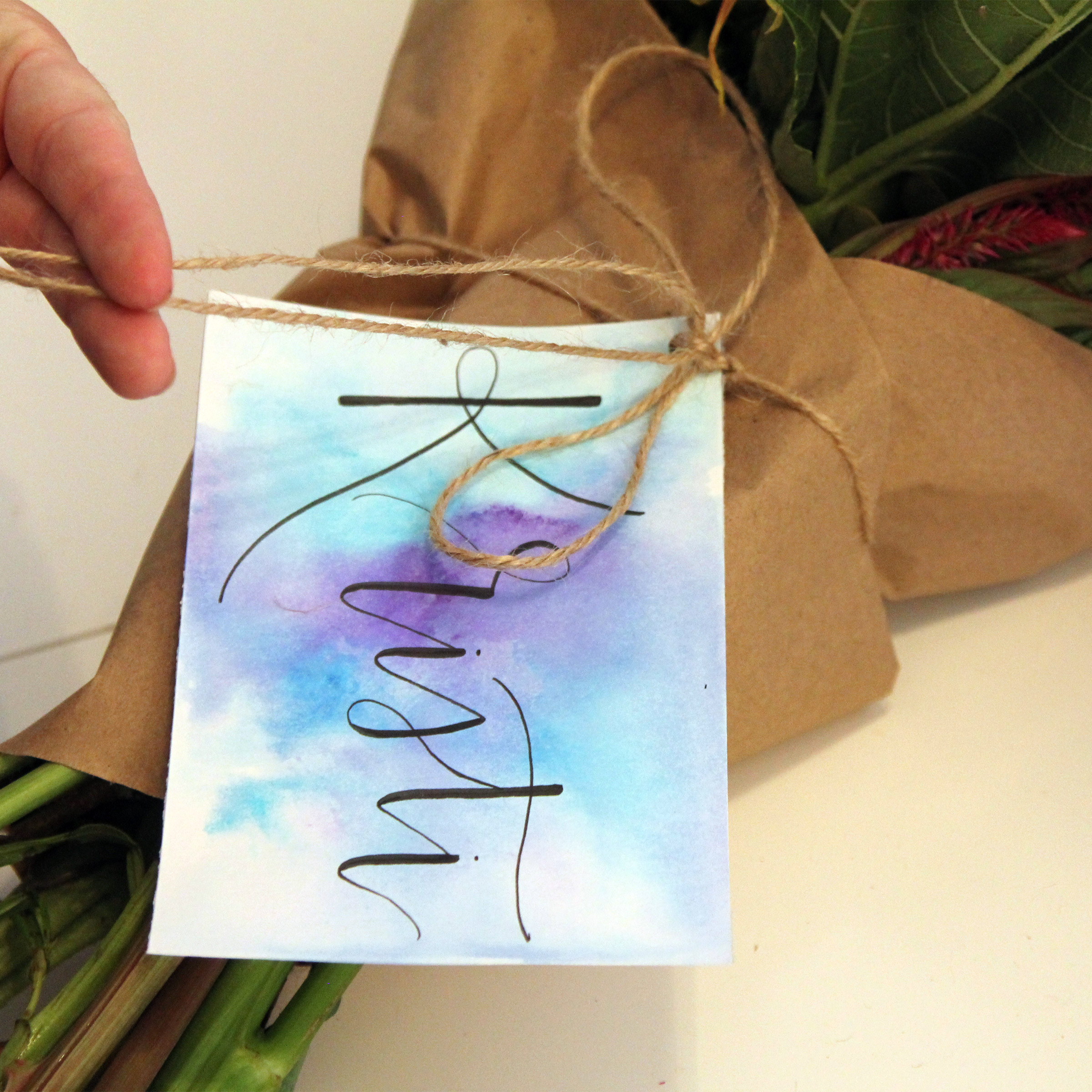Calligraphy card on bouquet
