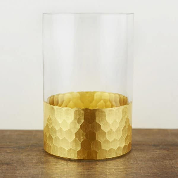 Glass vase with gold honeycomb pattern at bottom.