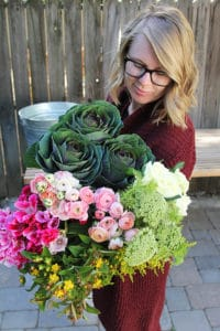Amanda, founder of Bloom, holding DIY flower bouquet