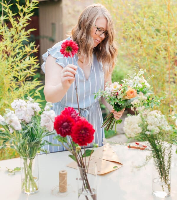 Amanda Kitaura of Bloom Sacramento arranging a DIY bouquet of locally grown flowers.