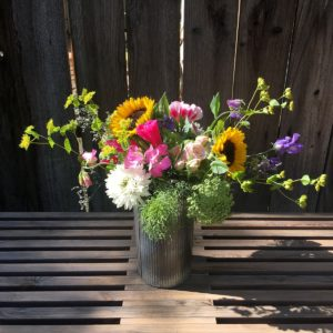 Bloom bouquet on wooden table.