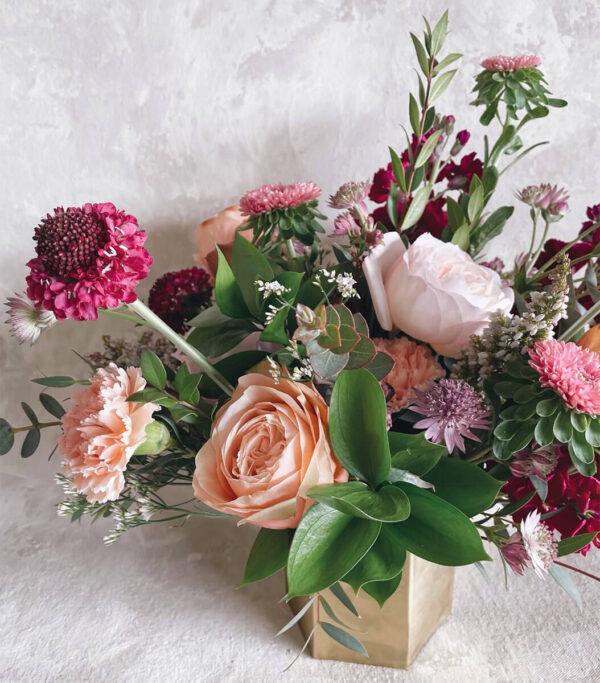 Valentine's Day bouquet arranged by Bloom Sacramento in gold, hexagonal vase.