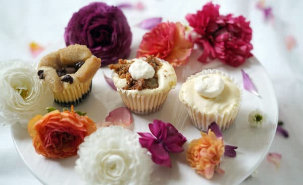 Flowers from Bloom and mini cheesecakes from Creamy's by Cayla Jordan on a plate.