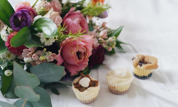Flowers and miniature cheesecakes.