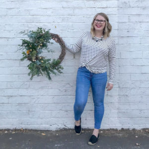 Amanda of Bloom Sacramento holds a wreath.