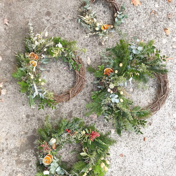 Four wreaths made by Bloom Sacramento.