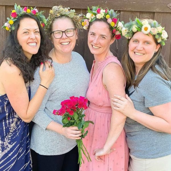 Four women wearing flower crowns made by Bloom Sacramento.