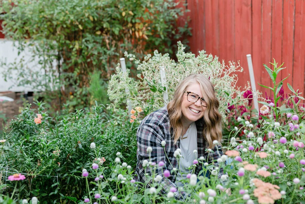 Amanda Kitaura of Bloom Sacramento among flowers she grew on her suburban flower farm.