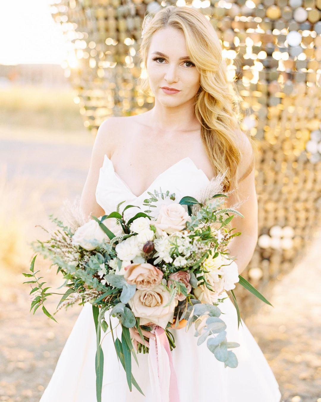 Bridge holds wedding bouquet designed by Bloom Sacramento