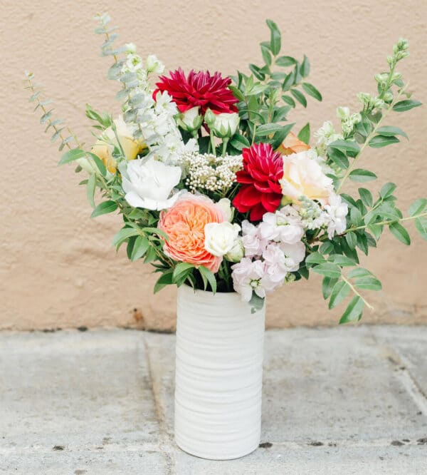 Tall and skinny white vase from Bloom Sacramento.
