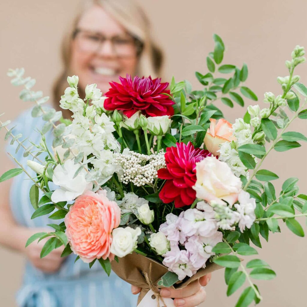 Amanda Kitaura of Bloom Sacramento holds a bouquet of local flowers